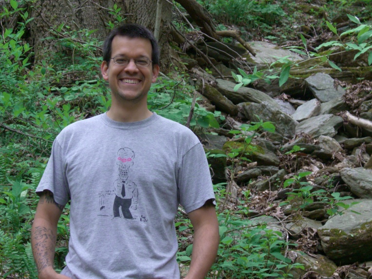 Photo of me hiking in the woods near the Susquehanna river.